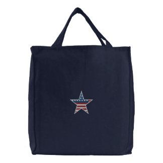 Den broderade patriotiska stjärnan hänger lös broderad tygkasse