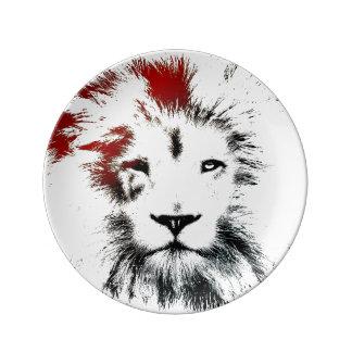 Den dekorativa lejona minsta designen pläterar porslinstallrik