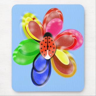 den färgglada glödande blomman med gullig musmatta