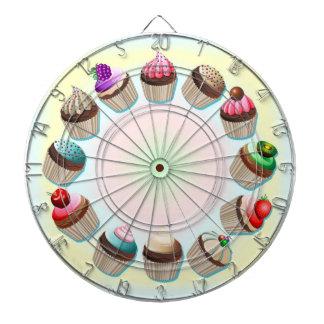 Den färgrika muffinsen cirklar pilen stiger ombord darttavla
