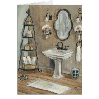 Den franska badrummen med spegeln och sjunker hälsningskort