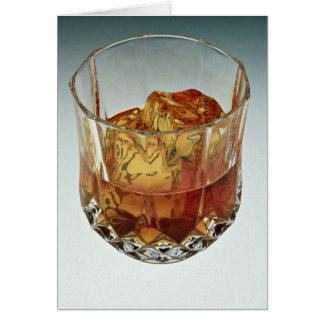 Den Glass tumbleren fyllde med scotch och iskuber Hälsningskort