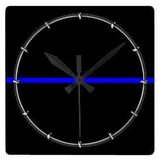 Den grafiska symboliska tunna blålinjen fyrkantig klocka