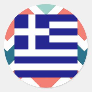 Den Grekland flagga boxas på färgrik sparre Runt Klistermärke