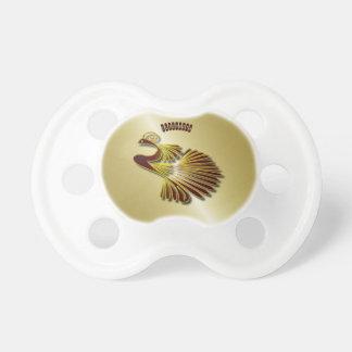 Den guld- chokladjuvelpåfågeln med guld skuggar napp