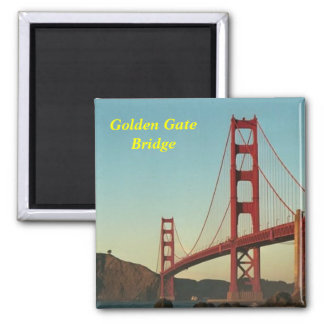 Den guld- grinden överbryggar magneten magnet