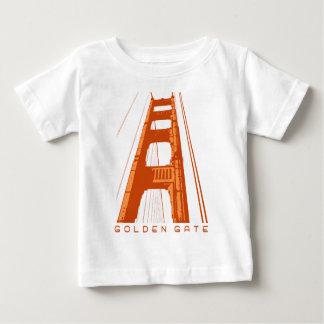 Den guld- grinden överbryggar torn - orange tröjor