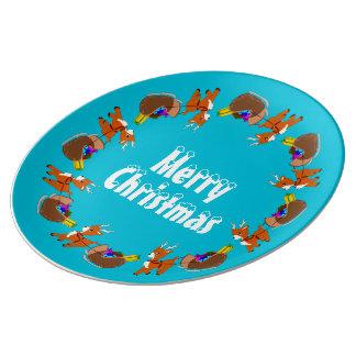 Den gulliga sleighen för julrenw pläterar lite porslinstallrik