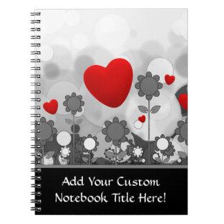 Den gulliga svarten/vit/grå färg blommar röd anteckningsbok med spiral