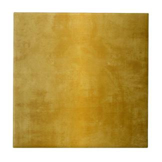 Den hem- dekoren betonar metalliskt guld liten kakelplatta