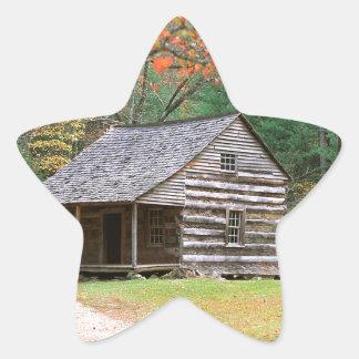 Den historiska platsen loggar kabinen i rökigt stjärnformat klistermärke