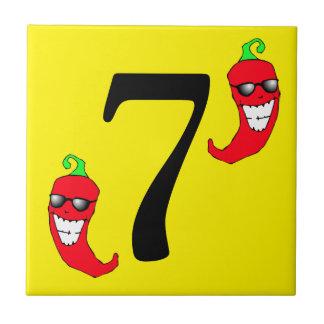 Den kalla röda Chilipepparhetten numrerar 7 sju Kakelplatta