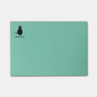 Den klibbiga katten postar det anteckningsboken post-it lappar
