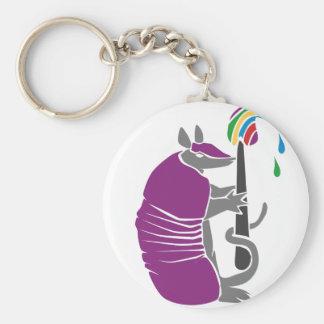 Den konstnärliga bältdjuret med målar borstar rund nyckelring