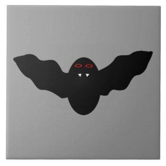 Den kusliga Halloween vampyrfladdermöss belägger m Stor Kakelplatta
