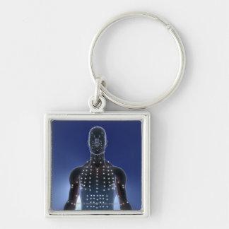 Den ljusa kartan av akupunktur pekar fyrkantig silverfärgad nyckelring