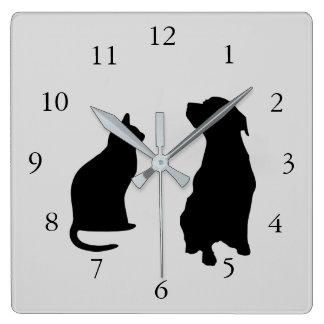 Den moderna katthunden silhouettes husdjur grånar fyrkantig klocka