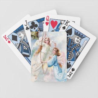 Den nätt änglar med sätta en klocka på spelkort