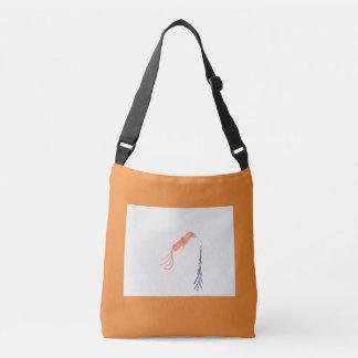 Den orange crossbody totot hänger lös med nätt axelväska