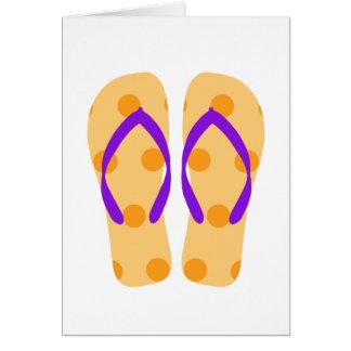 Den orange flinflip flops för sommarstrandparty hälsningskort