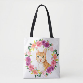 Den orange tabby katt med blom- krantoto hänger tygkasse