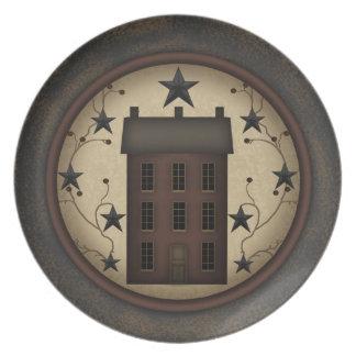 Den primitiva röda Saltbox husmelaminen pläterar Tallrikar