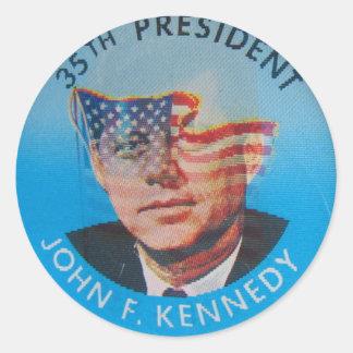 Den Retro vintagehötorgskonstJohn Kennedy blinkern Runt Klistermärke
