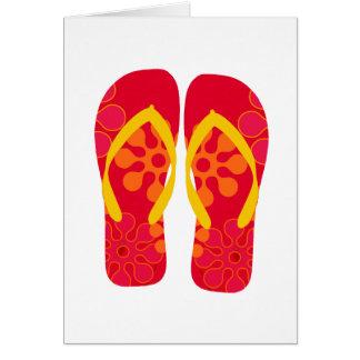 Den röda flinflip flops för sommarstrandparty hälsningskort