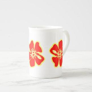 Den röda hibiskusen blommar tropiska hawaianska tekopp