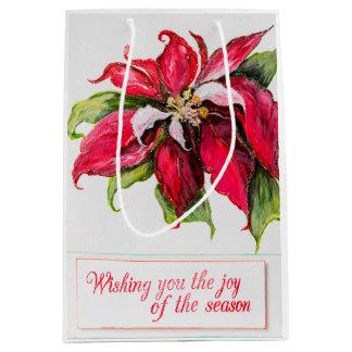 Den röda julstjärnagåvan hänger lös
