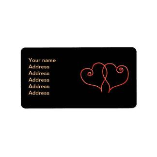 Den röda och svart valentinesen virvlar runt adressetikett