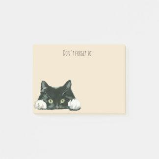 den roliga katten postar det noterar den svart post-it block