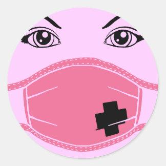 Den rosa läkarundersökningen maskerar grafiskt runt klistermärke