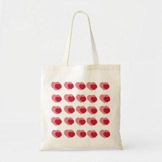 Den rosa och röda dubbla hjärtatotot hänger lös budget tygkasse