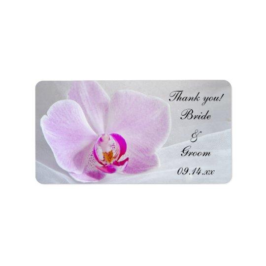Den rosa orchiden och skyler märkre för adressetikett