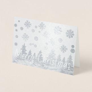 Den snöig skogen omkullkastar julkortet folierat kort