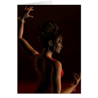 Den spanska flamencodansare på en mörk arrangerar hälsningskort
