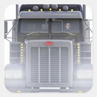 Den svart halva lastbilen med främre ljus beskådar fyrkantigt klistermärke