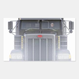 Den svart halva lastbilen med främre ljus beskådar rektangulärt klistermärke
