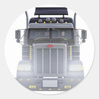 Den svart halva lastbilen med främre ljus beskådar runt klistermärke