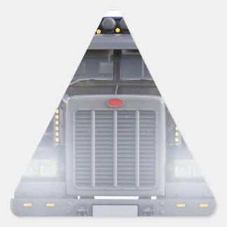 Den svart halva lastbilen med främre ljus beskådar triangelformat klistermärke