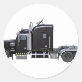 Den svart halva lastbilen med fulltljus i sida runt klistermärke