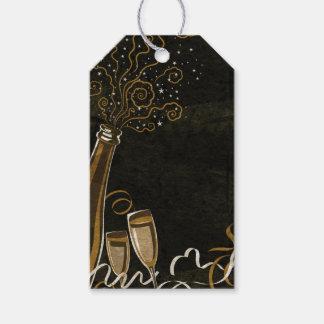 Den svart och guld- champagneglasflaskan virvlar pack av presentetiketter