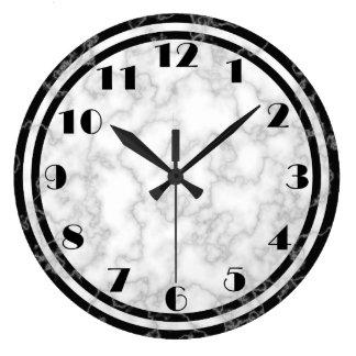 Den svartvita art déco tar tid på stor klocka
