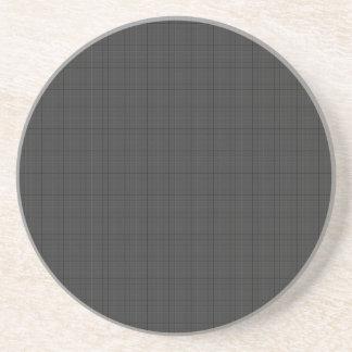 Den texturerade svarten kvadrerar underlägg sandsten
