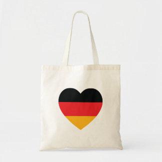 Den tysklanda flaggahjärtatotot hänger lös budget tygkasse