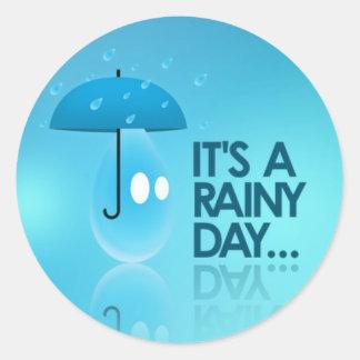 Det är en regnig dag runt klistermärke