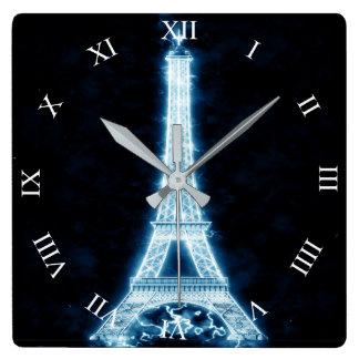 Det Eiffel torn i vitneonglöd kvadrerar väggen tar Fyrkantig Klocka