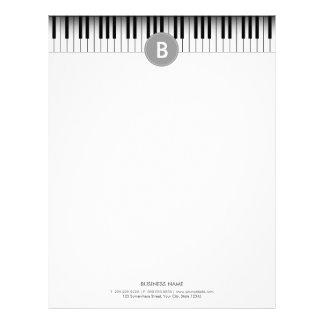 Det eleganta Monogrampianot stämm brevhuvudet Brevhuvud