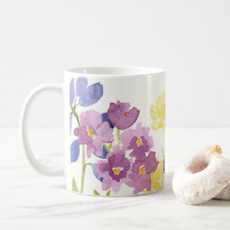 Det färgglada vildskottet blommar akvarellmuggen kaffemugg